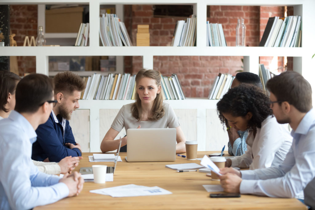 Blog - Serious leader executive speaking at corporate team meeting